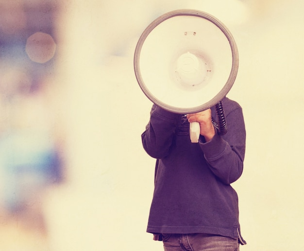 Boy with a megaphone next to his face