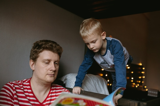Boy with mother reading christmas book