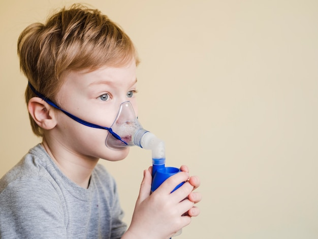 Boy with oxygen mask
