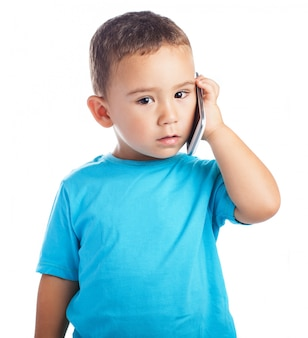 Boy with a phone in his ear