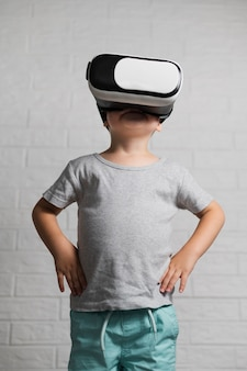 Boy with virtual headset at home