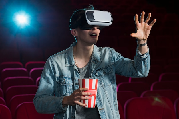 Boy with vr glasses in cinema