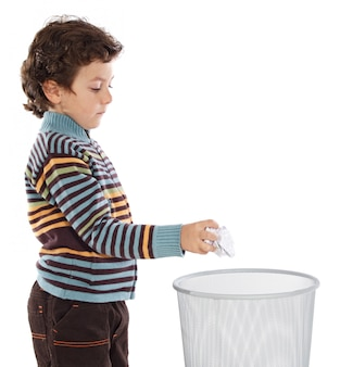 Boy with wastebasket over a white background