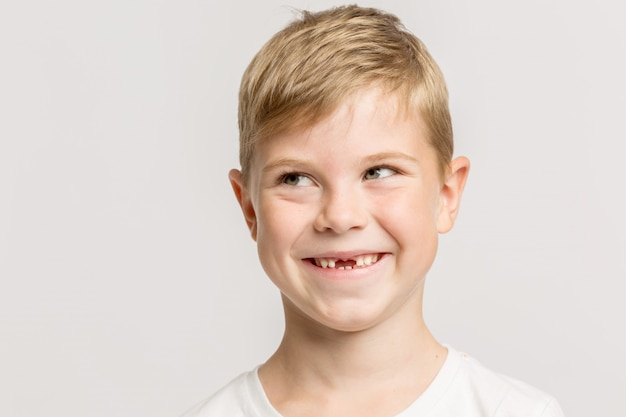 A boy without anterior teeth smiling