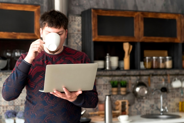 Boy working on grey laptop