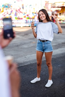 Boyfriend taking photo of girlfriend
