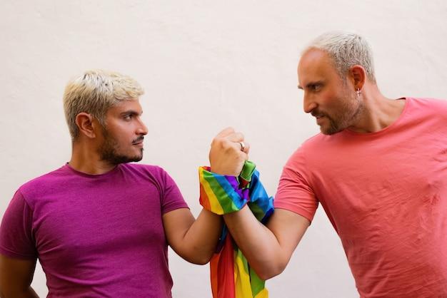 Boyfriends tied with lgbt flag