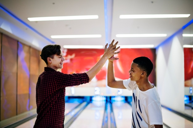 Boys bowling together after school