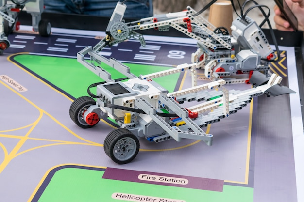 Boys and girls construct and programming code robot lego