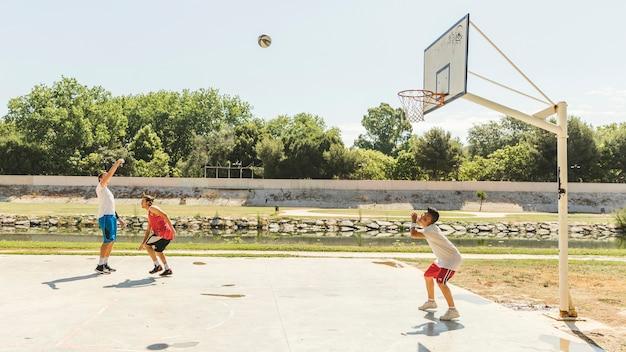 Boys playing basketball game