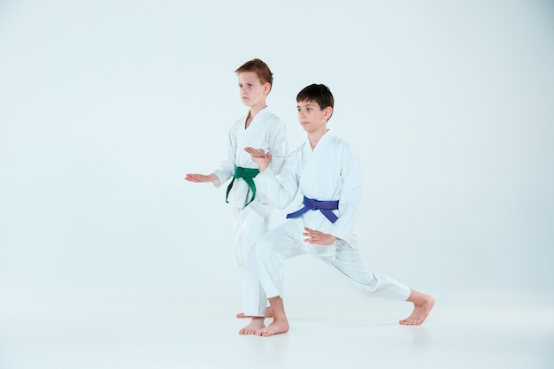 Boys posing at aikido training in martial arts school. healthy lifestyle and sports concept