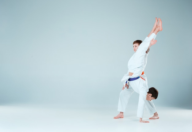 The boys posing at aikido training in martial arts school. healthy lifestyle and sports concept