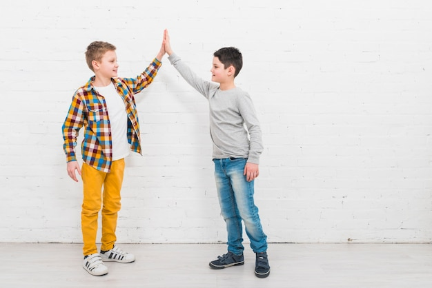 Boys presenting copyspace