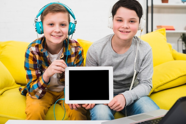 Boys presenting tablet
