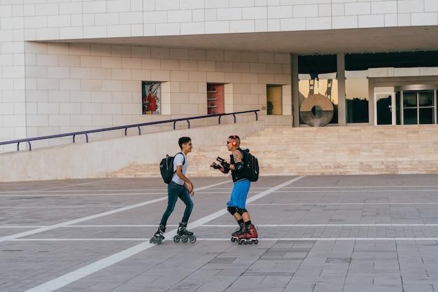 Boys skating in a square.