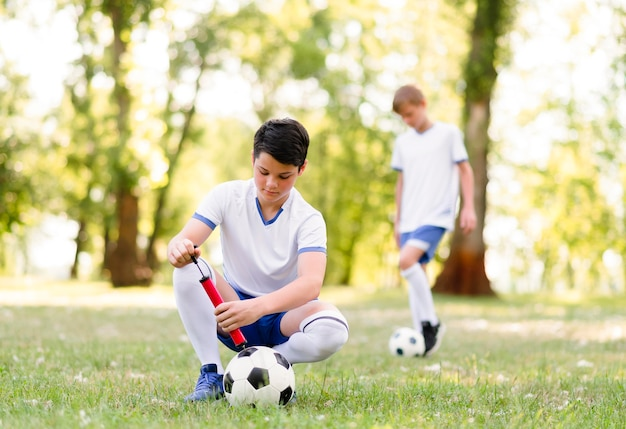 Boys training for a football match outdoors