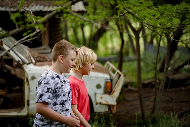 Boys walking in an abandoned area having adventures together
