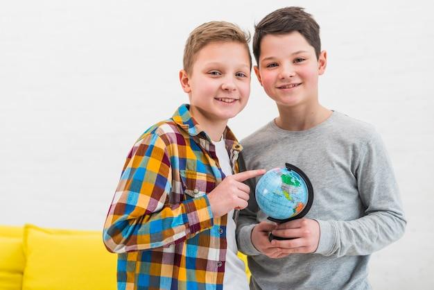 Boys with globe