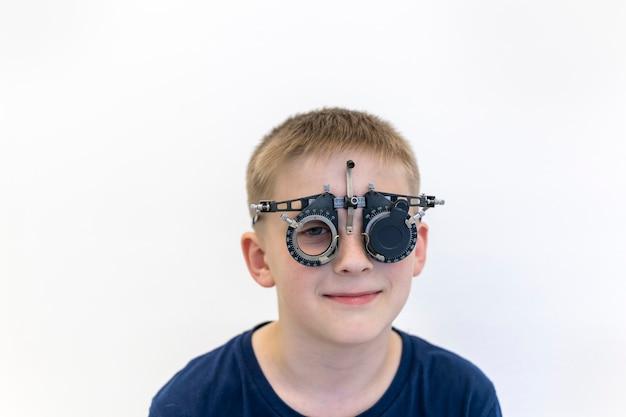 Boyseyesight is being checked optometrist checks childs eyesight equipment of ophthalmologist on