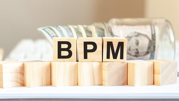 Bpm word written on wooden blocks