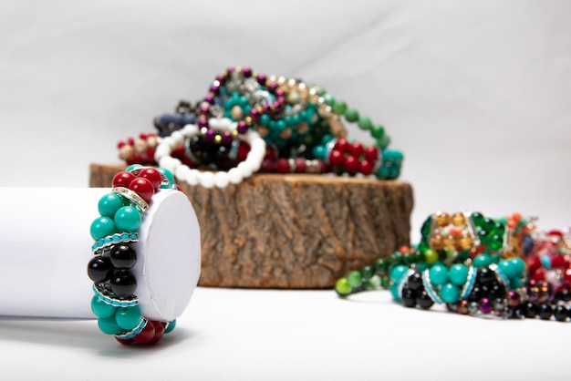 Bracelets made by colorful pearls and stones.