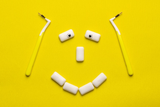 Braces cleaning concept with funny smile face shaped chewing gums pads