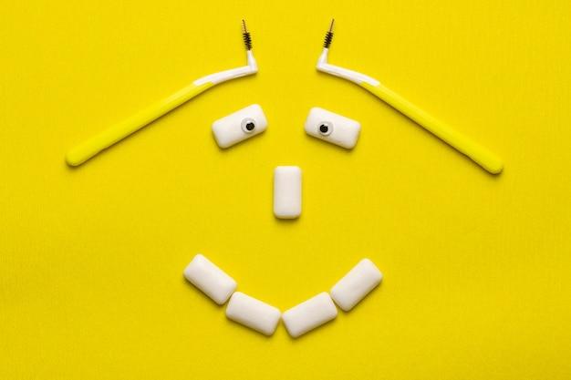 Braces cleaning funny concept with smile face shaped chewing gums pads.