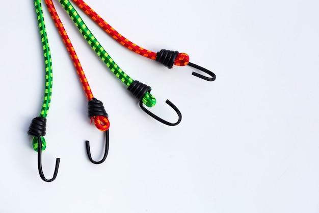 Braided elastic strap with hooks on white background.