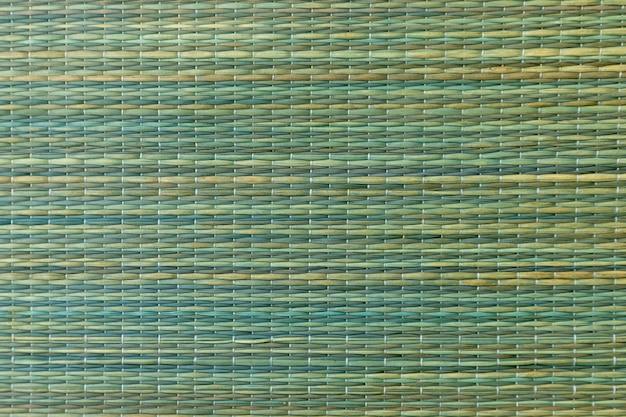 緑のトーンの編組繊維の質感