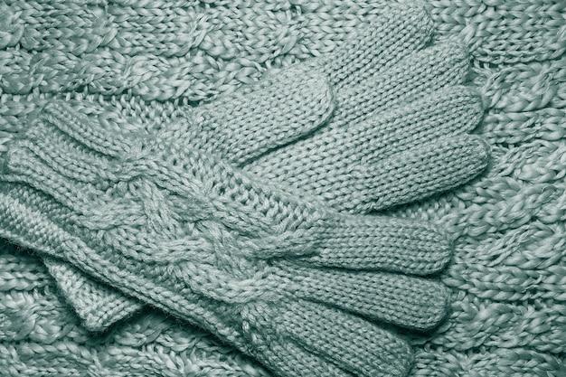 Braids in machine knitting pattern. wool hand-knitted or machine knitting pattern. closeup fabric background