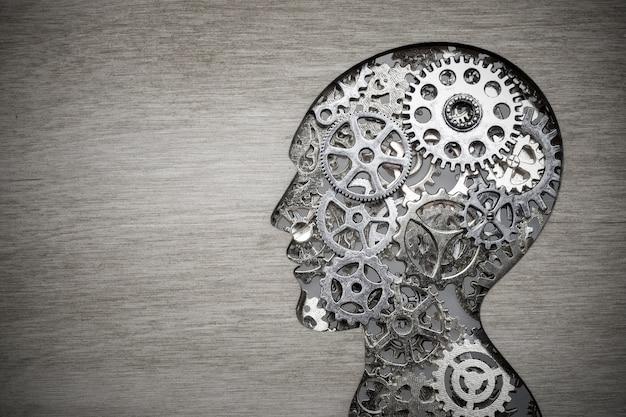 木製の歯車と歯車から作られた脳モデルの概念