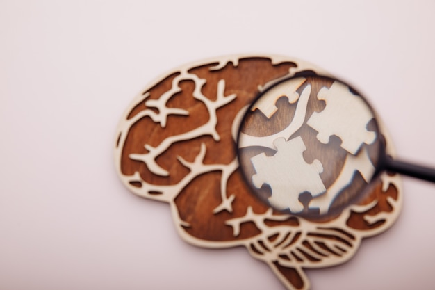 Brain with wooden puzzles. mental health and problems with memory concept.