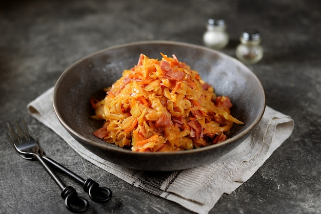 Braised cabbage with ham, onions and carrots