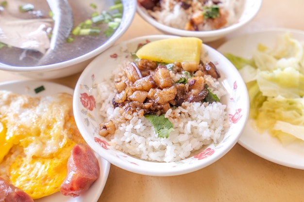 Braised pork over rice - taiwan famous traditional street food delicacy. soy-stewed pork on rice.