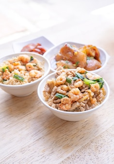 Braised shrimp over rice - taiwan famous traditional street food. soy-stewed prawn on cooked rice.