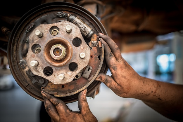 Brake repair or inspections of brake systems and the replacement of new brake pads held by mechanics who change car brake pads in car repair shops