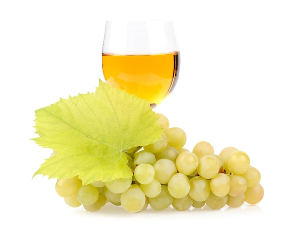 Branch of grapes and glass of wine isolated on white