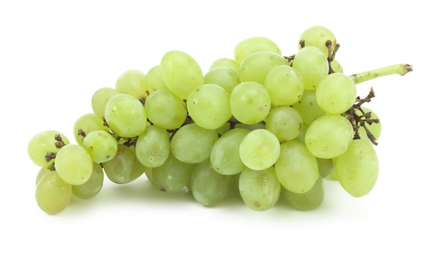 Branch of green grapes on a white surface