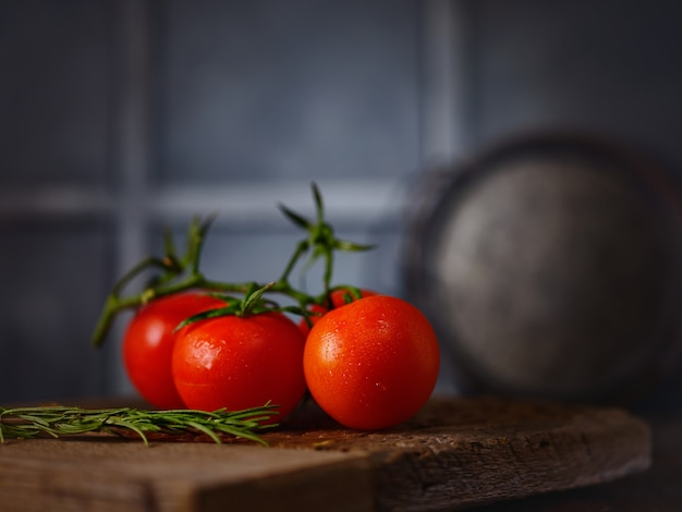 Branch of tomatoes on the table