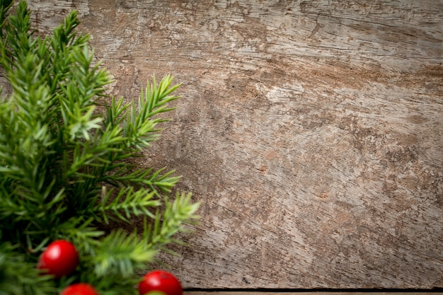 Branches arborvitae, juniper branches on wood christmas backgrou