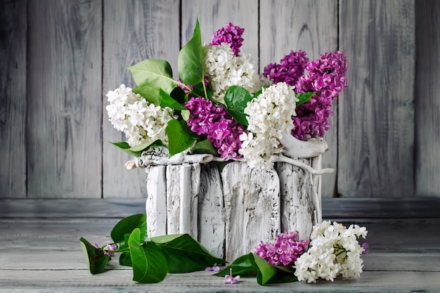 Branches are colored lilac in a basket