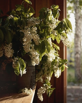 Branches of a flowering bush in a vintage vase