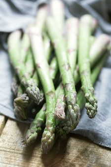 Branches of fresh green asparagus on wooden table