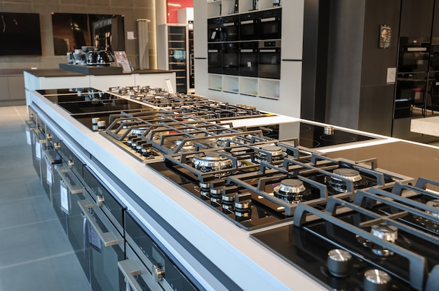 Brand new gas stoves in apliance store showroom