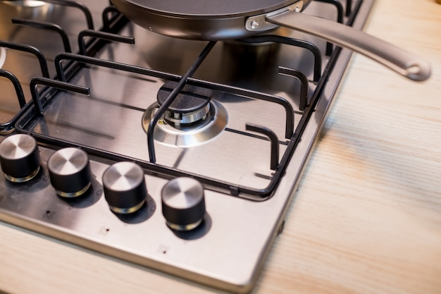 Brand new metal gas stove on modern kitchen. the concept of forced savings on utilities stove.