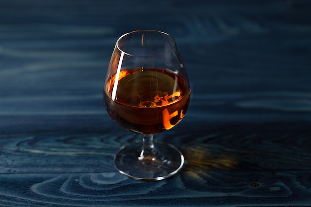 Brandy glass on the wooden table