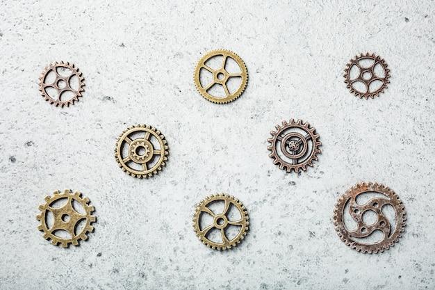 Латунные зубчатые колеса, поверхность в стиле стимпанк, концепция текстуры