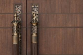 Brass handle vintage style on  wood door brown colour