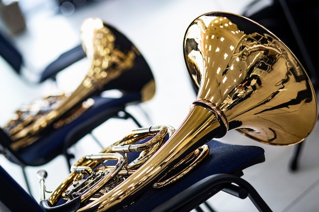 Brass instruments lie on chairs during a break in a symphonic music concert