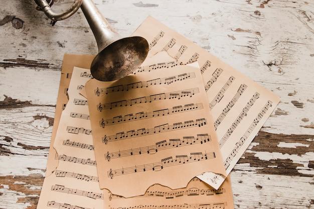 Brass trumpet on sheet music